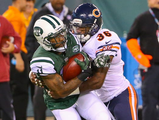 New York Jets wide receiver Jeremy Kerley (11) catches a pass and is tackled by Chicago Bears defensive back Ahmad Dixon (36).