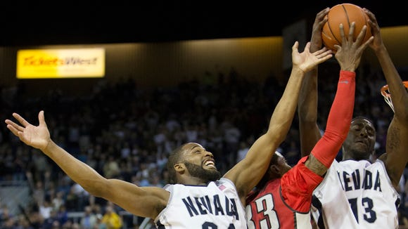 Nevada's Cole Huff grabs a rebound against  UNLV  during their basketball game played at Lawlor Events Center on March 8, 2014 in Reno, Nevada.