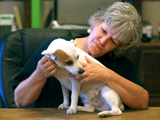 Volunteer Kimberly Rezk plays with Sassy on Thursday,