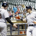 Miami Marlins' Justin Bour (48) congratulates Derek Dietrich as he crosses home after hitting a two-run home run during the fourth inning against the Milwaukee Brewers Monday in Milwaukee.