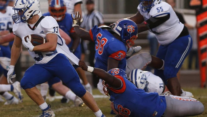 Oconee County's Justin Coleman (33) breaks a tackle from a Cedar Shoals defender during an GHSA high school football between Cedar Shoals and Oconee County in Athens, Ga., on Friday Sept. 11, 2020.
