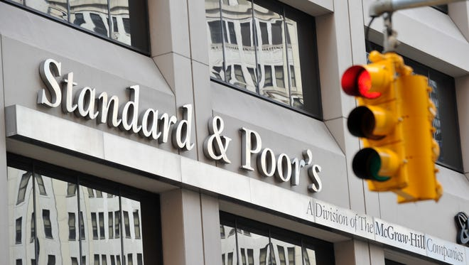 Credit-rating agencies Standard & Poor's, Moody's and Fitch are blamed for contributing to the financial crisis by giving unwarranted high ratings to risky securities.