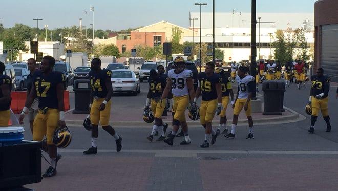 The Wolverines walk into Michigan Stadium for practice Saturday.