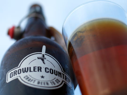 A 32-ounce beer from Growler Country, sold to-go at