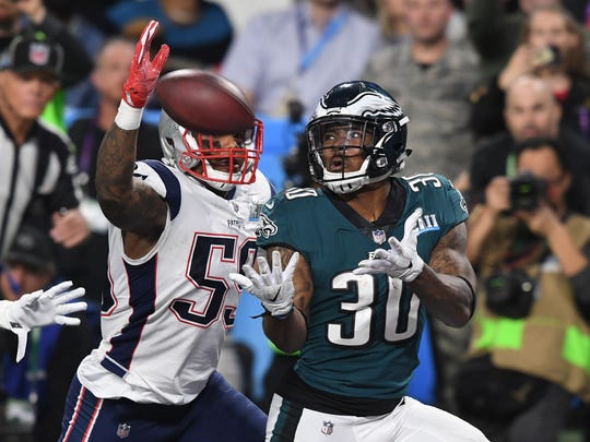 Philadelphia Eagles running back Corey Clement (30) catches a touchdown pass in front of New England Patriots linebacker Marquis Flowers (59) during the third quarter in Super Bowl LII at U.S. Bank Stadium.