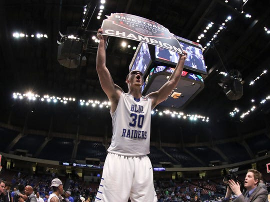 Middle Tennessee's Reggie Upshaw celebrates after the Blue Raiders defeated Old Dominion in the Conference USA Tournament title game Saturday.