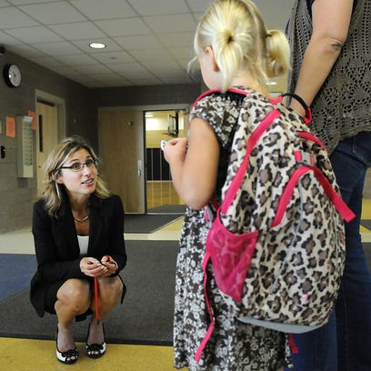 First-year principal at Kennedy Community School in St. Joseph Laurie Putnam asks students in a fifth-grade class if anyone else is new to the school. Monday was Putnam's first day as principal at Kennedy Community School.