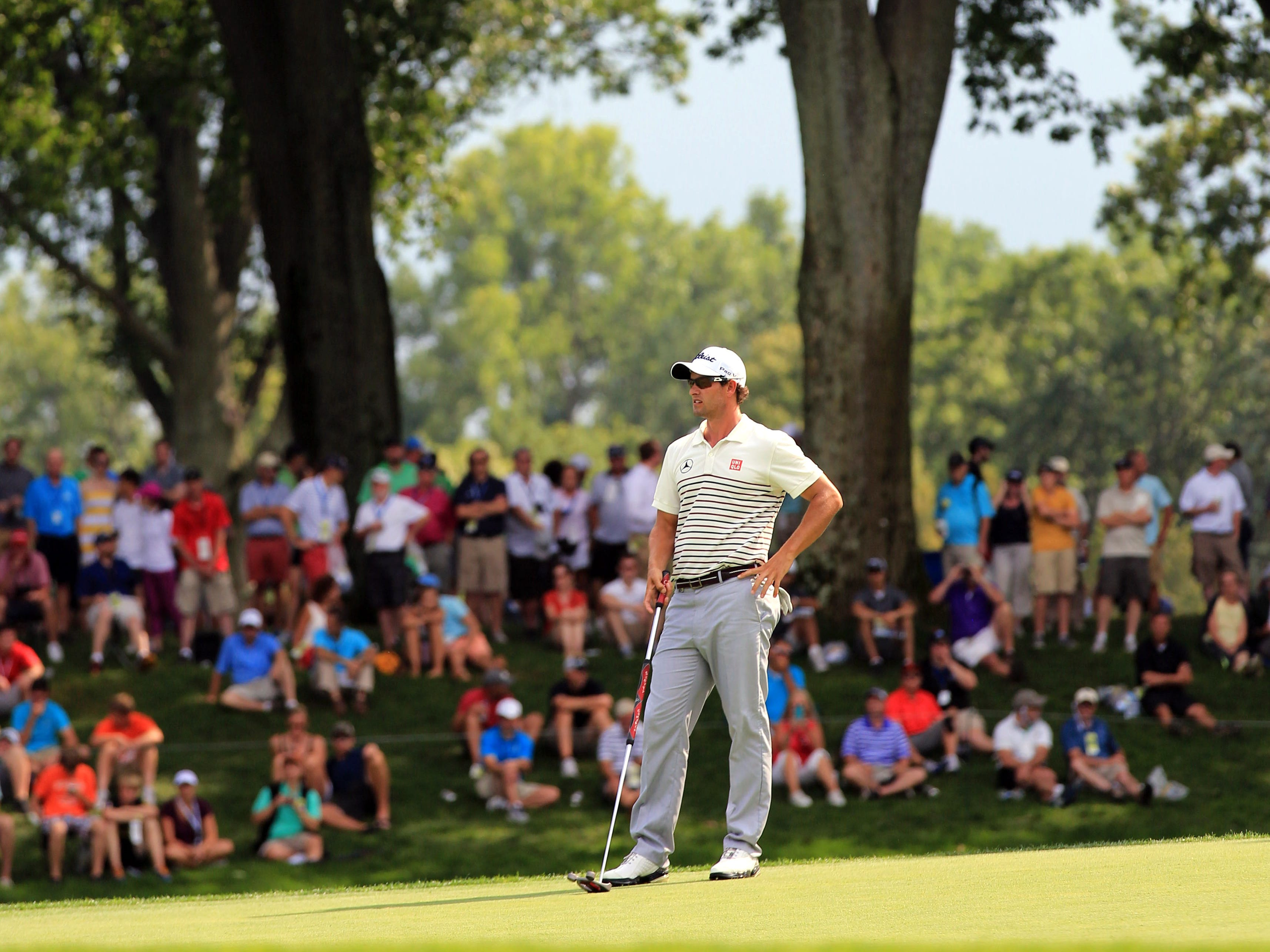 Adam Scott waits to putt on the 9th green during the first round of the 95th PGA Championship at Oak Hill Country Club.