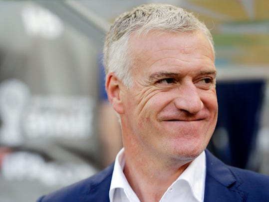 France's head coach Didier Deschamps waits for the start of the World Cup quarterfinal soccer match between Germany and France at the Maracana Stadium in Rio de Janeiro, Brazil, Friday, July 4, 2014. (AP Photo/Matthias Schrader)