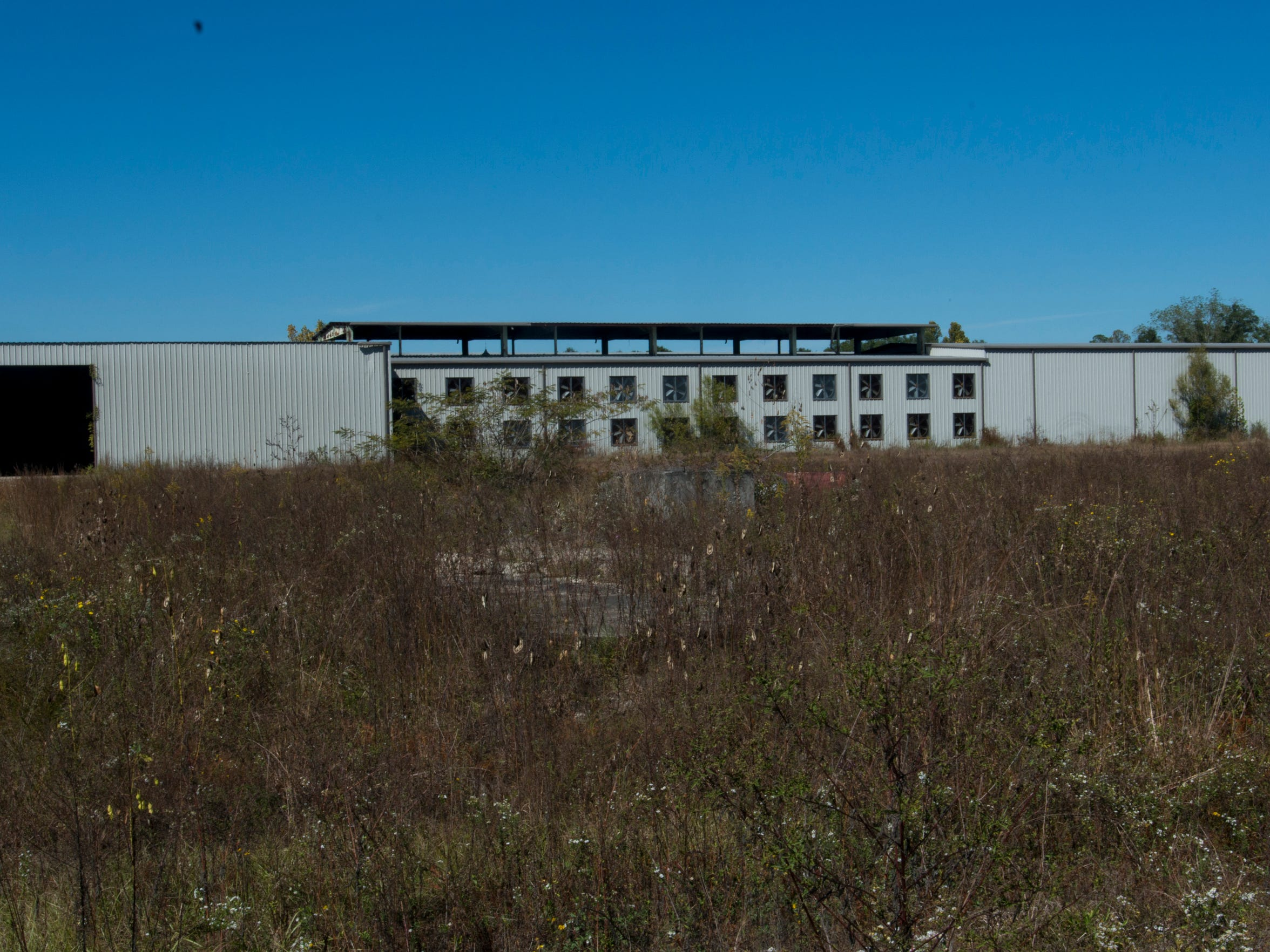 A derelict and forgotten mill in the Northern Escambia County town of Century sits on an overgrown lot and abandoned.
