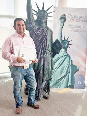 """Thirty-eight years after he arrived in the United States as an eight-year-old boy Ricky Delao held up his right hand and gave the """"Oath of Allegiance"""" to the United States of America.  He gave up his long-held green card and became a naturalized American citizen excited to enjoy all the rights and benefits that come with that designation.  Delao, 46, from Bowie celebrated this landmark day with his children, Monica, Lexis and Colby, who were visibly proud of their dad. He joined 42 other immigrants on July 23 in a naturalization ceremony in Irving.  When asked why it took him so long to seek out citizenship, Delao does not hesitate to say he should have done it a long time ago, but he decided more than a year ago it was finally time.  """"I have been here a lot of years and I should have done it before because it has so many opportunities that come with it, such as voting,"""" said Delao. A new country Delao was born in Juarez, Mexico just across the border from El Paso. His father traveled into the U.S. every day on a work visa to provide for his family returning home to Mexico each night. His mother was a stay at home mom who with her husband would raise six children, all boys. Two of those boys were born in the United States.  """"My dad made much better money coming over here and he wanted to save as much as he could to bring us to the United States. That happened around 1980 when I was eight,"""" recalls Delao. Coming into Texas the family immediately began applying for their green cards. He says back then it was easier, but it did cost quite a bit. When they came it also was a lifetime card with no time limit. Now it is renewable very 10 years.  The United States lawful permanent residency informally called a green card is the immigration status of a person authorized to live and work in America permanently. A person with a green card can apply for citizenship or naturalization after five years of residency.  As a youngster Delao and his siblings were scared and nervous o"""