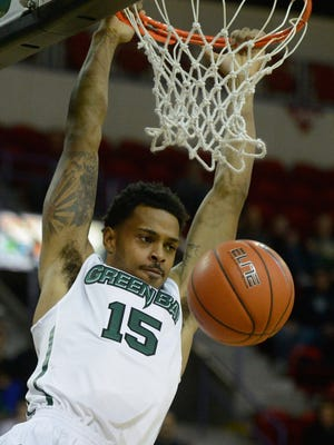 UWGB forward Greg Mays dunks in the first half of the game against Morehead State at the Resch Center.