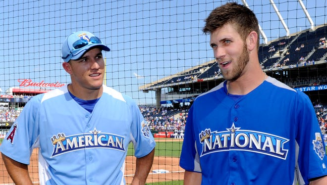 Mike Trout, left, and Bryce Harper visit with each other during batting practice at the 2012 All-Star Game in Kansas City.