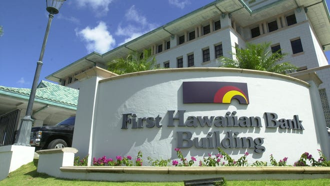 First Hawaiian Bank's main Guam branch, along Route 8 in Maite, conducts business as usual in this 2010 file photo.