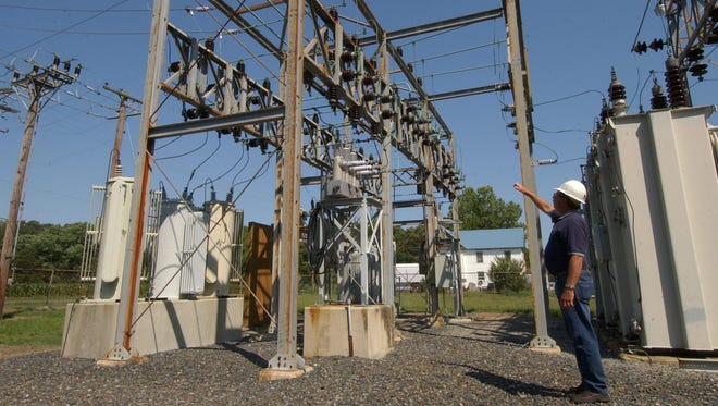 In this 2007 file photo, Barry Williams, substation supervisor with Delmarva power explains the importance of exercising safety around such structures. The company is seeking a 12.5 percent electricity rate increase to help pay for reliability improvements.