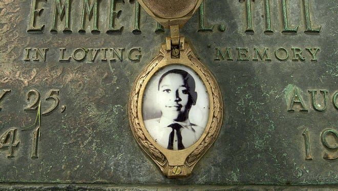 Emmett Till's photo is seen on his grave marker in Alsip, Ill. Till's killing was a galva- nizing event in the civil rights movement. Emmett Till's photo is seen on his grave marker in Alsip, Ill. Till's killing was a galvanizing event in the civil rights movement.