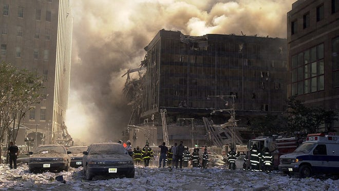 Rescue workers survey the remains of the World Trade Center on Sept. 11, 2001.