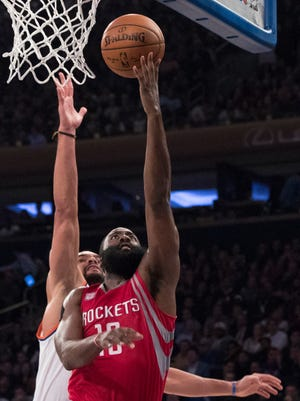 Houston Rockets guard Eric Gordon (10) goes to the basket past New York Knicks center Joakim Noah during the first half of an NBA basketball game, Wednesday, Nov. 2, 2016, at Madison Square Garden in New York.