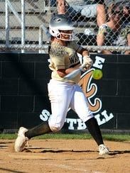 Abilene High's K'Ci Walker hits the ball during the