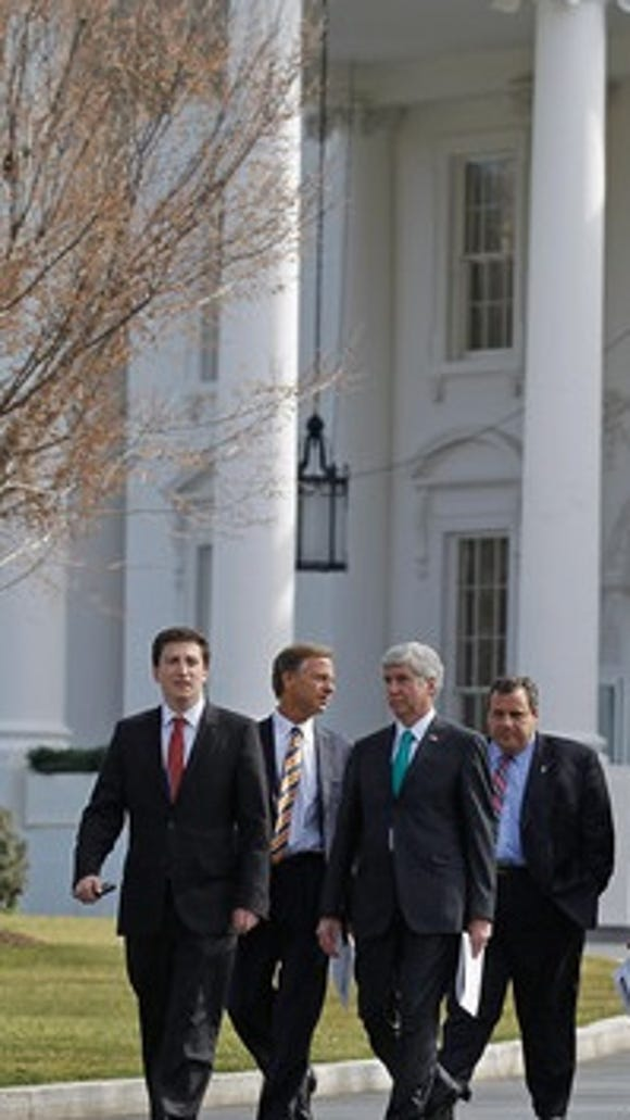 Tennessee Gov. Bill Haslam (2nd from left) and Gov. Chris Christie (far right) leave the White House after a National Governors Association event in February 2012. (Chip Somodevilla/Getty Images)