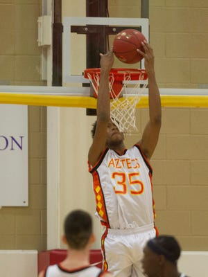Corona del Sol's Marvin Bagley III makes a reverse dunk against Sierra Canyon during the Hoophall West basketball showcase at Chaparral High in Scottsdale, AZ on January 3, 2015.