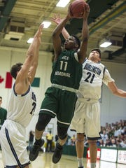 Rice Memorial's Ben Shungu goes up for a shot between Burlington's Kevin Garrison and Kaden Rosamilia in the Division I high school boys state basketball championship in March.
