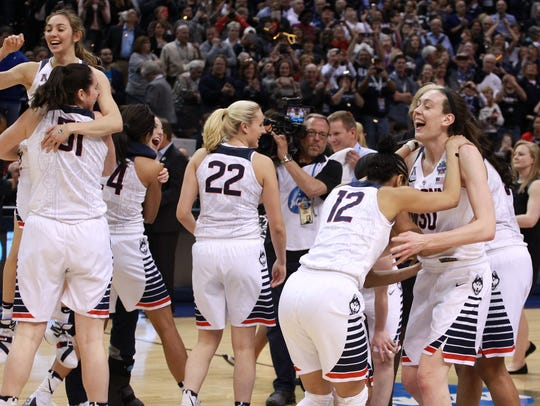 The Connecticut Huskies players celebrate after defeating