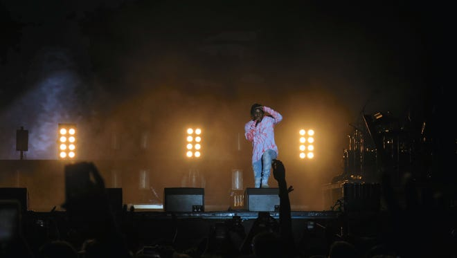 Rapper Kendrick Lamar looks out at the audience during his headlining performance at the Austin City Limits Music Festival.