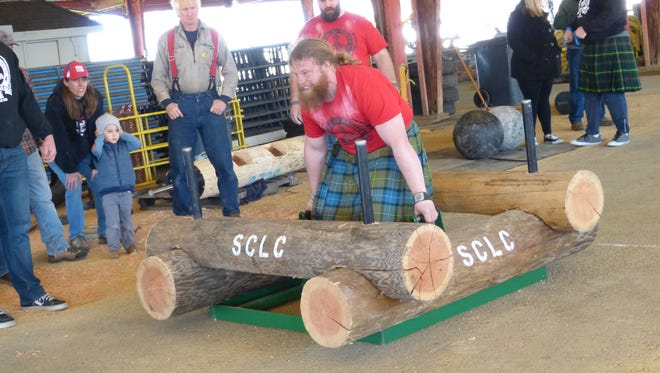 Chase Wiley of Idaho attempts to lift and carry 850 pounds off the floor during the World's Strongest Logger Competition at Saturday's Sierra-Cascade Logging Conference.