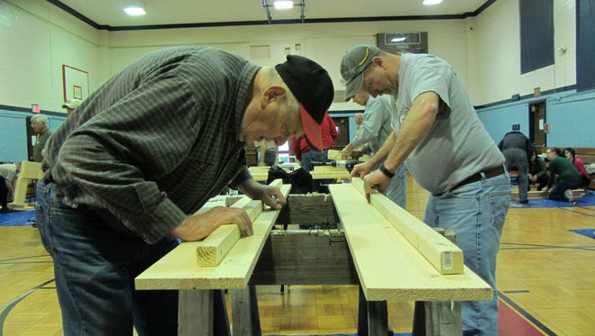 Volunteer Doug Wisher builds a bed for the Build A Dream project.