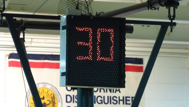 High school girls basketball players compete during a regular season game in Anderson, Calif., on Feb. 14, using the 30-second shot clock. The shot clock for boys is 35 seconds in California. Oregon does not use a shot clock in high school.