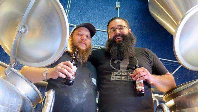 Brannon Radicke, brewmaster at Austin's Independence Brewing Co., and Albert Salinas, brewmaster of El Paso's Ode Brewing Co., take a break from working on their first collaboration. The duo's peach gose will be available at the restaurant and brewery in about three weeks.