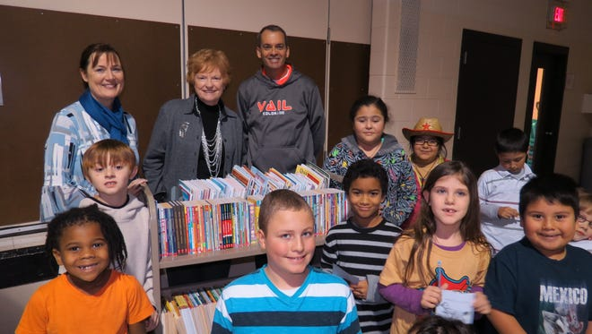 Pictured with students at Parkside Elementary School are, from left: Rhonda Roehrig, Penny Werner and Tom Schuman, members of the Fond du Lac Morning Rotary.