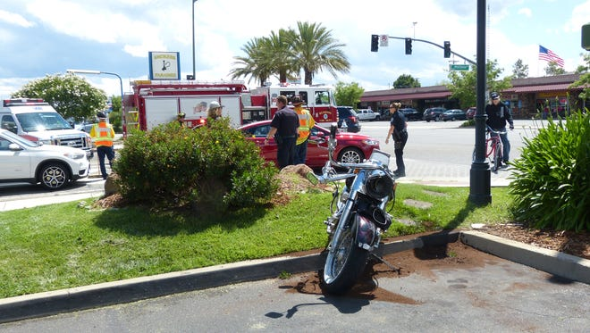 A Redding motorcyclist was injured Friday when a car apparently changed lanes in front of him, police said.