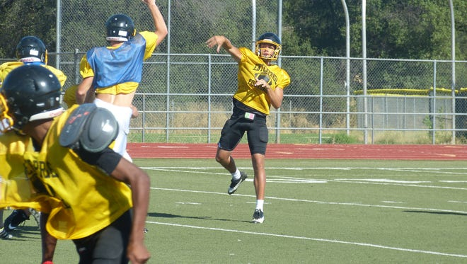 Leslie Cummings throws the football during an Enterprise High practice in August.