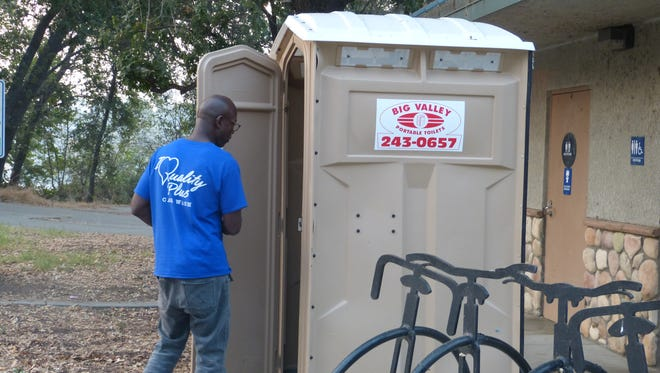 A Lake Redding Park visitor avails himself to a portable toilet after first trying early Friday morning to enter the park's locked restrooms.
