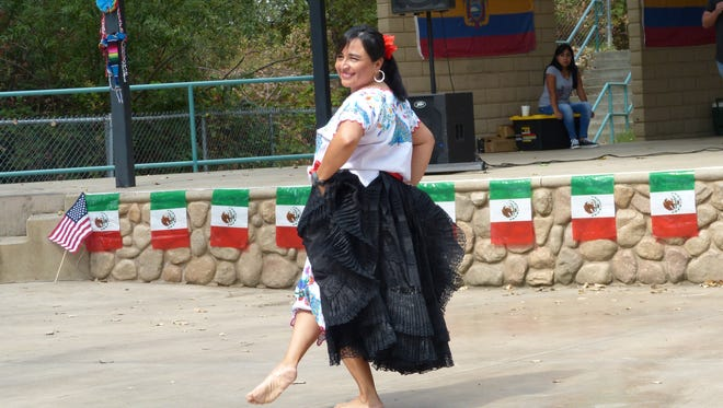 """Cecilia Cabrera, 47, performs a Peruvian dance number, known as """"La Marinera,"""" for an audience Saturday at the Anderson River Park Amphitheater."""