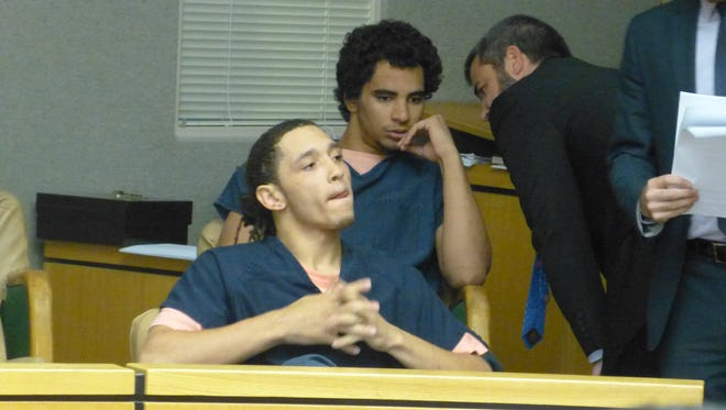 Devin Sutton-Wilson, foreground, and Isaiah Williams, back row, are charged with first-degree murder in the death of a Redding teenager, among other crimes.