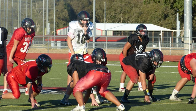 Foothill players practice Tuesday in preparation for Friday's home game against Enterprise.