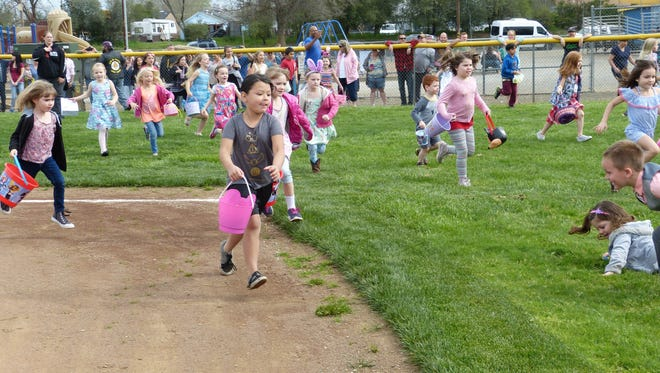 Children scrambled through Volonte Park to gather Easter eggs on Saturday.