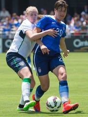 Ireland forward Ruesha Littlejohn (8, left) and USA forward Abby Wambach (20) fight for the ball during the first half.