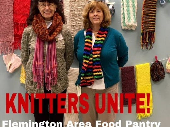 Linda Buurma of Knitters Unite and a food pantry volunteer, displays some of the handmade scarves for the food bank with Cheryl Grotrian of the Hunterdon County Library.