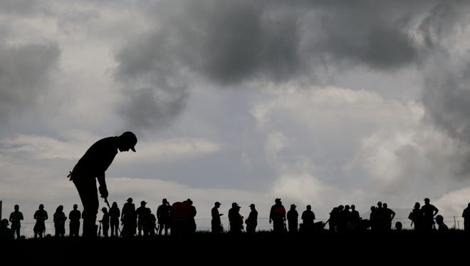 Jul 22, 2018; Nicholasville, KY, USA; Golfers wait on the putting green as play is suspended due to rain in the final round of the Barbasol Championship golf tournament at Keene Trace Golf Club. Mandatory Credit: Mark Zerof-USA TODAY Sports