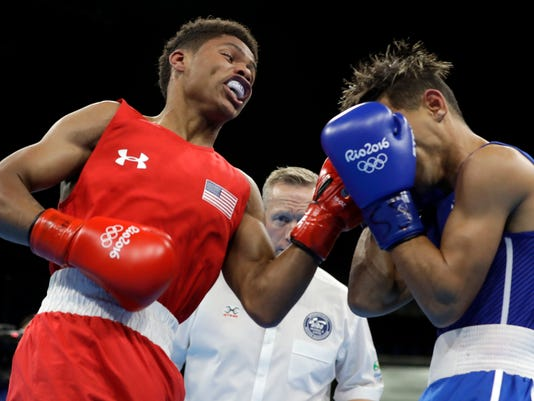FILE - In this Aug. 20, 2016, file photo, United States' Shakur Stevenson, left, fights Cuba's Robeisy Ramirez during a men's bantamweight 56-kg final boxing match at the 2016 Summer Olympics in Rio de Janeiro, Brazil. Stevenson is the most compelling American prospect in boxing after his run to a silver medal in Rio. The teenager is eager to start down a fast track to a title shot when he makes his pro debut this weekend in the famed outdoor ring in Carson, California. (AP Photo/Frank Franklin II, File)