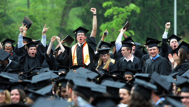 Graduates cheer during Rowan's commencement ceremony. Friday, May 15, 2009.