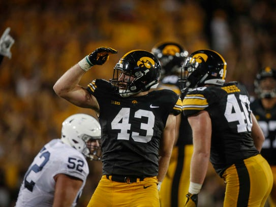 Iowa senior linebacker Josey Jewell celebrates after