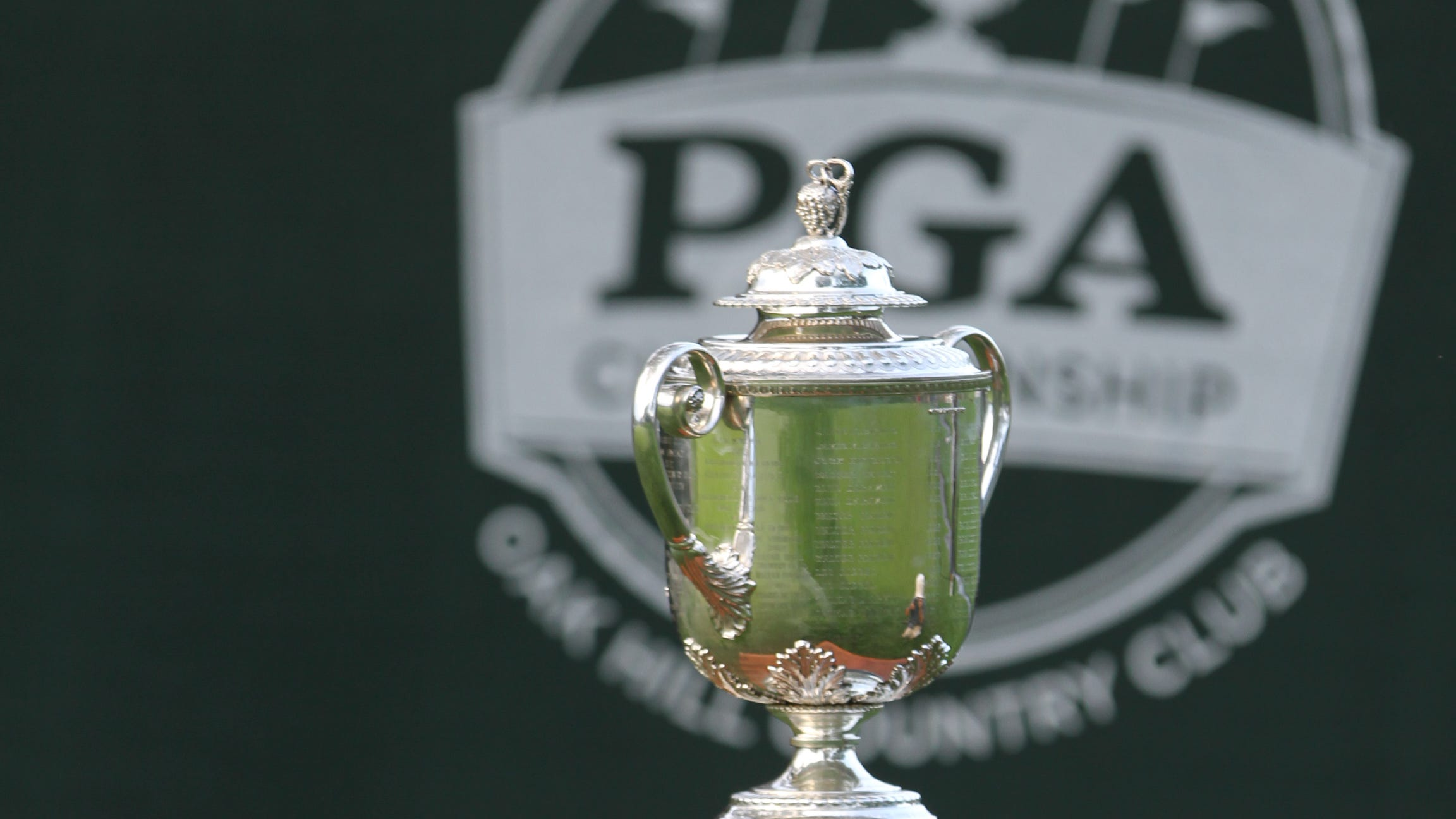Wanamaker Trophy sits near the tee box on the first hole at Oak Hill.