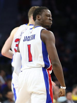 Reggie Jackson reacts after making a basket late in the fourth quarter of the Pistons' 109-95 win over the Bulls on March 6, 2017 at the Palace.