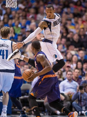 April 12: Monta Ellis and Dirk Nowitzki scored a combined 58 points to lead the Dallas Mavericks past Phoenix Suns, and into the playoffs.
