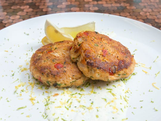 Chef Nathan Butner's gluten-free crab cakes with tequila lime crème fraîche dish at South Market restaurant in Pace on Monday, August, 28, 2017.  South Market is one of the local restaurants competing in the Florida Chef Challenge, a fundraiser for Feeding the Gulf Coast.